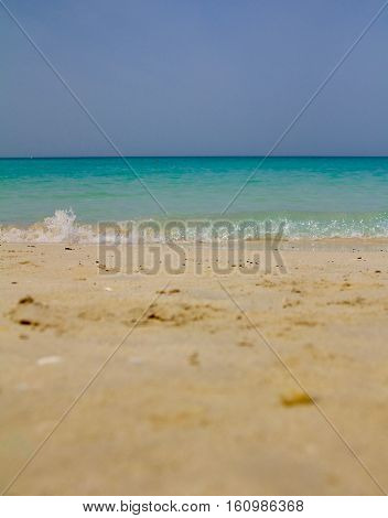 A vertical shot of the Jumeirah beach in Dubai, UAE (soft focus on the bottom sand area)
