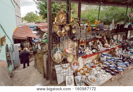 TBILISI, GEORGIA - SEP 24, 2016: Antique sell on the flea market Dry Bridge with buyers of art old utensils and retro souvenirs on September 24, 2016. Tbilisi has a population of 1.5 million people