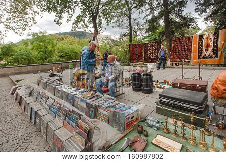 TBILISI, GEORGIA - SEP 24, 2016: Seller of vinyl records waiting for music buyers at the popular flea market Dry Bridge on September 24, 2016. Tbilisi has a population of 1.5 million people