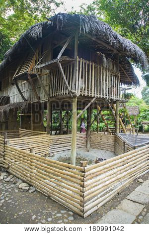 Replica of an old bamboo and hay jungle hut, on chicken legs, in a national park in Guayaquil, Ecuador.