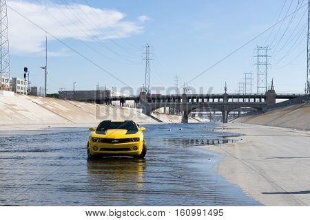 Los Angeles USA - September 28 2015: Chevrolet Camaro in Los Angeles river. Historic 6th Street viaduct bridge built in 1932 crossing the L.A. River.
