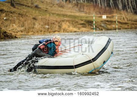 Beklenischevo, Russia - April 29, 2006: Rafting as extreme and fun sport. Athletes work actions when capsizing a raft