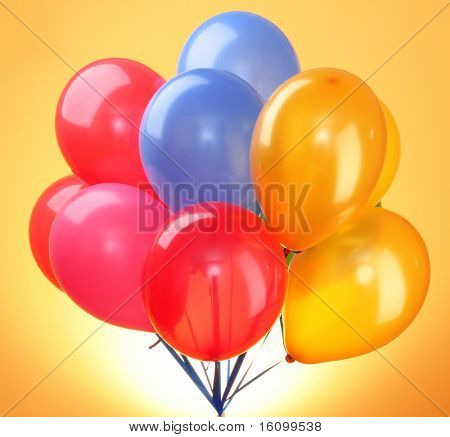 Pink flying balloons  on a yellow background
