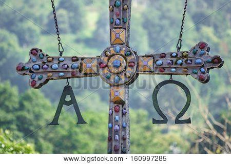 Closeup view of hanging cross in roman bridge of Cangas de Onis, Principado de Asturias, Spain