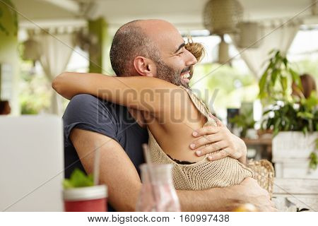 Charismatic Man With Stubble Embracing His Female Friend, Holding Her Tightly, Happy With Her Career