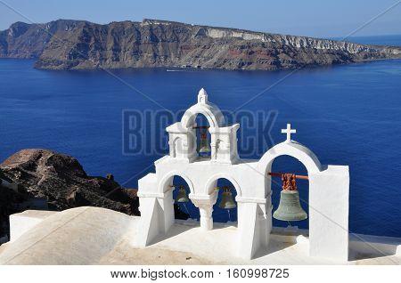view to santorini caldera. white orthodox church in Santorini island, Greece