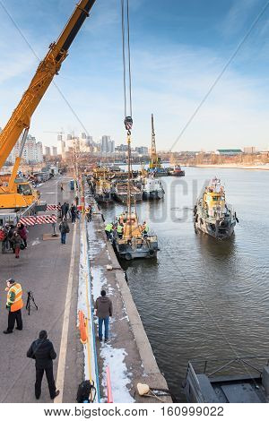 MOSCOW, RUSSIA - NOVEMBER 11, 2016: State Unitary Enterprise Mosvodostok performs recovery vessels on coastal winter parking. The water area of the river port on the Moscow River.