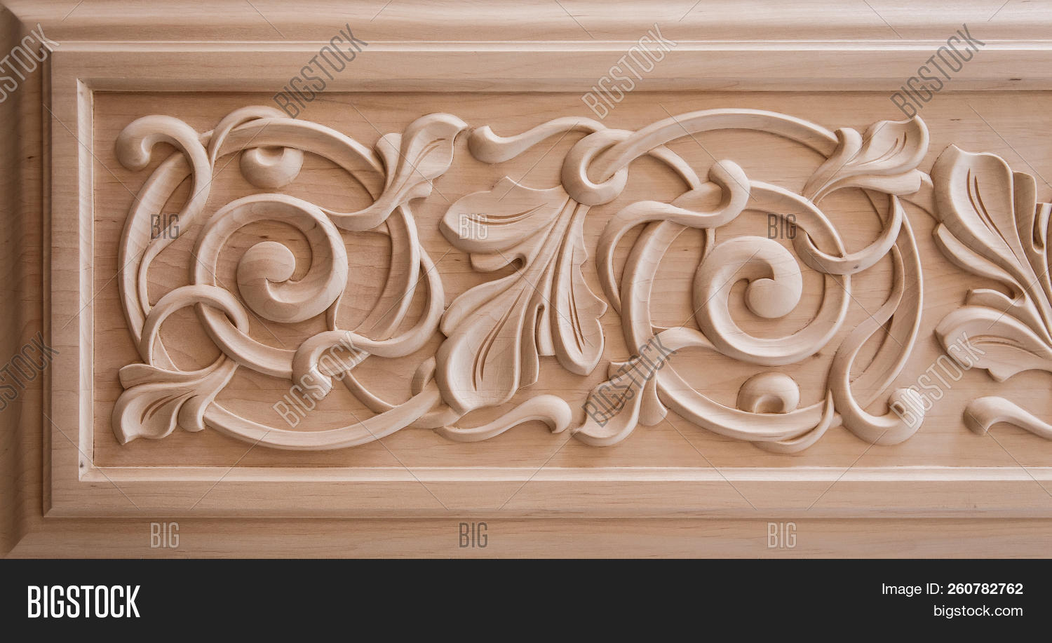 stock photo wood processing joinery work wood carving decorative, abstract, floral ornament pattern of flowe