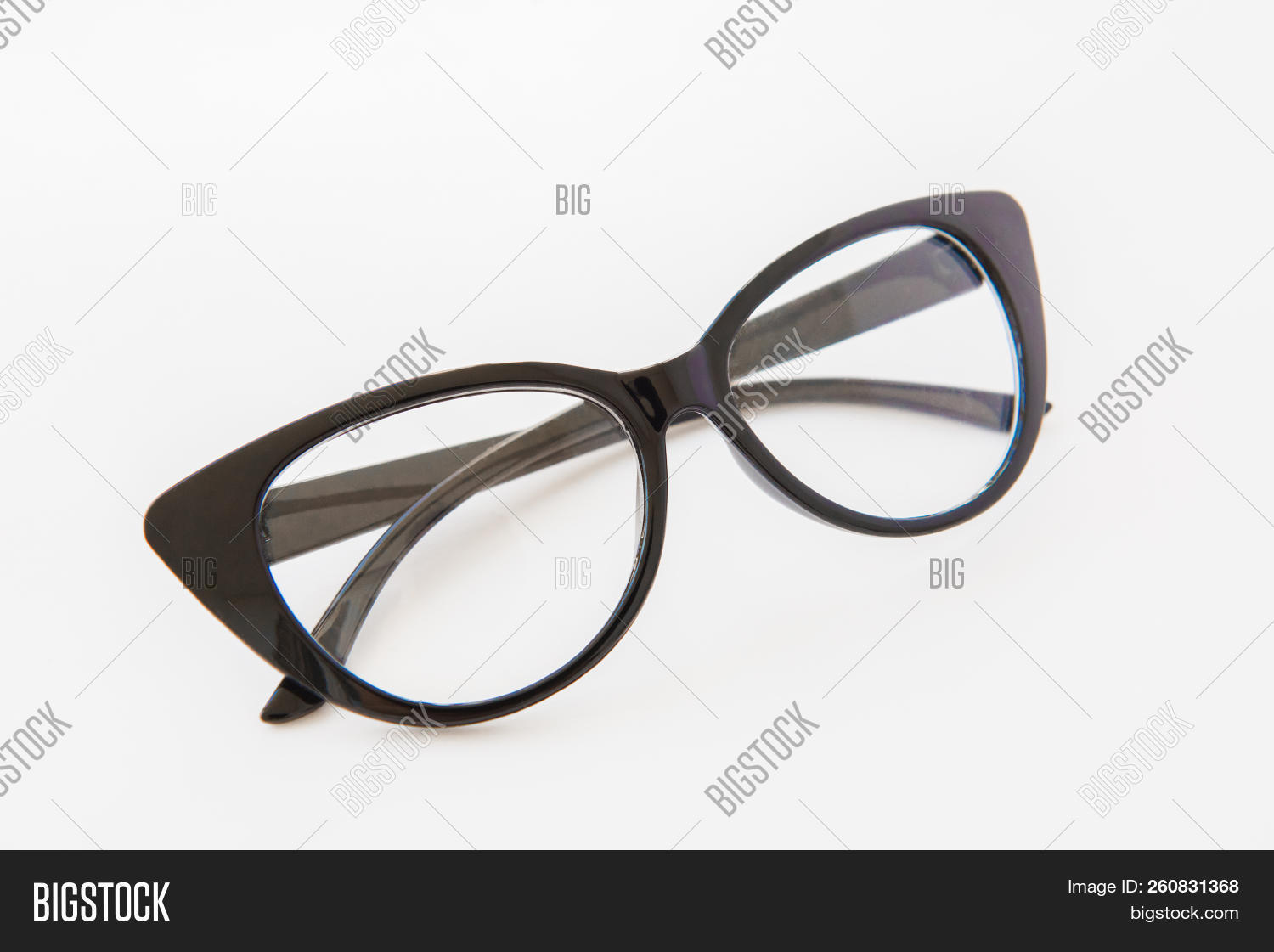 030cfafcbff6 Pair Of Reading Glasses Or Spectacles With Modern Dark Frames Folded Up On  A White Background