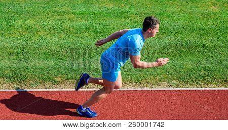 Sprinter Athlete Run Training. Athlete Run Track Grass Background. Sprinter Training At Stadium Trac
