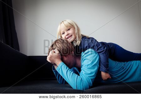 Difficult Parenting- Father Is Tired Having Headache While Daughter Plays Makes Noise