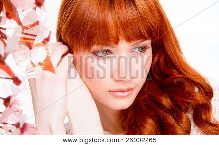 Portrait of beautiful caucasian young woman with green eyes