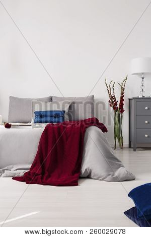 Eco Cotton Gray Sheets And Pillows And A Burgundy Blanket On A Bed In A Romantic Bedroom Interior. R