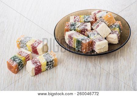 Multicolor Rakhat-lukum In Brown Transparent Saucer On Wooden Table