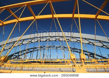 Bright Yellow Bridge Named Hogeweidebrug Over The Amsterdam-rhine Canal In Utrecht For Traffic In Th