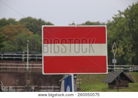Red And White Sign For Ships Which Means No Entry On This Side At River Hollandsche Ijssel In Gouda,
