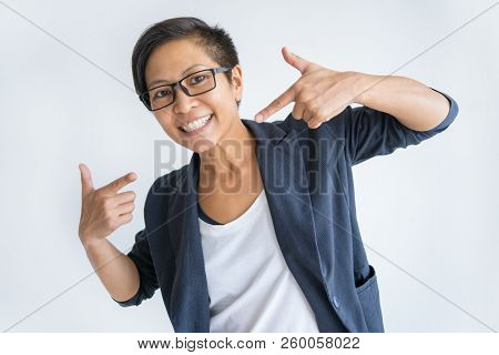 Happy Asian woman pointing at herself and looking at camera. Confident lady. Self-reliance concept. Isolated front view on white background. poster
