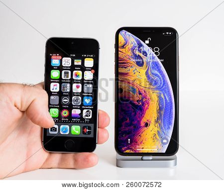 Paris, France - Sep 25, 2018: Male Hand Compare New Iphone Xs And Xs Max Smartphone Model By Apple C