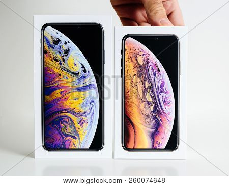 Paris, France - Sep 25, 2018: Man Hands Presenting New Iphone Xs And Xs Max Cardboard Box Compare Be