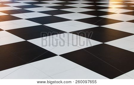 The Tiles Are A Checkered Pattern In Black And White.