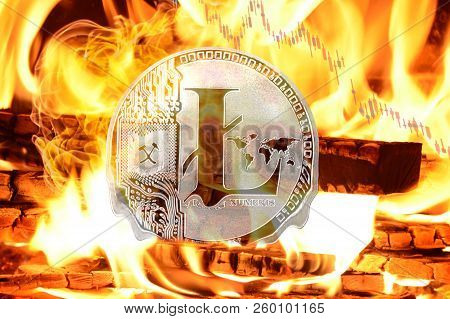 Litecoin Buring In Bonfire, Cryptocurrency Price Value Going Down, Concept Photo.