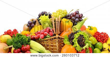 Healthy fresh vegetables and fruits in willow basket isolated on white. Copy space