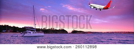 Australian Colourful Sunrise Seascape With An Airborne Passenger Jet Airliner Flying High In The Mag