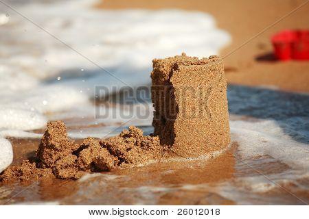 Castelo de areia - conceito de fazer salvar edifício