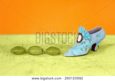 A Shoe Beside Squashed Green Grapes As A Conceptual Image For Stomping On Healthy Fruit And Rejectin