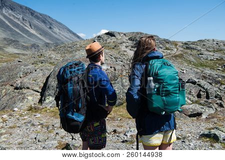 Hikers With Backpacks On Besseggen Ridge In Jotunheimen National Park, Norway