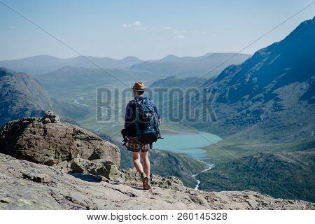 Man Hiking On Besseggen Ridge Over Gjende Lake In Jotunheimen National Park, Norway