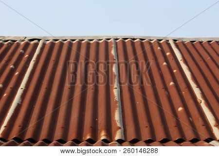 Side View Of Very Tin Roof Old With Rusty And Little Blue Sky At The Top