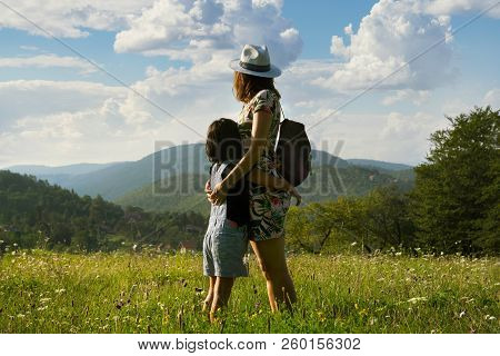 Mother And Child In Summer Vacation. Mother And Child Hugging In Meadow In Vacation. Summer Vacation