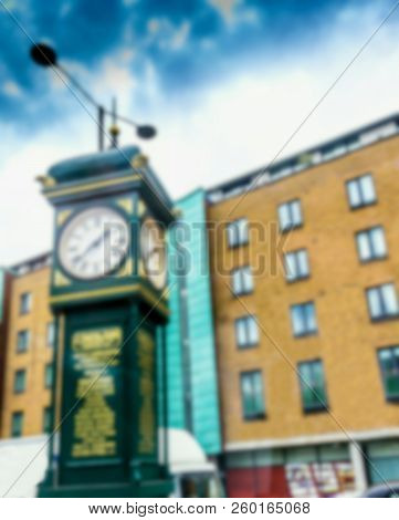 Blurred View Of J. Smith And Sons Clock Located On A Pedestrian Island Between Goswell Road And City