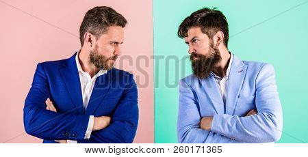 Business partners competitors in suits with tense bearded faces. Businessmen stylish appearance jacket pink blue background. Tense face expression competitors. Business competition and confrontation poster