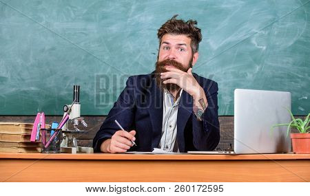Teacher Bearded Man Writing With Pen Busy With Paperwork. Teachers Daily Routine Paperwork And Writi