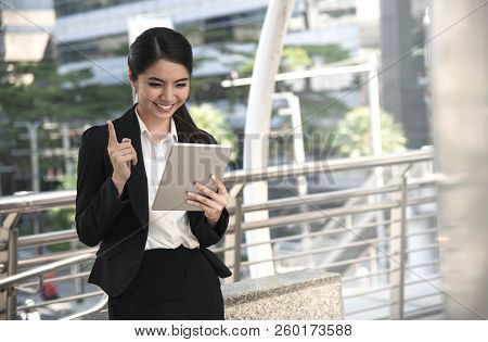 Happy Asian Business Woman Using Digital Tablet Computer.