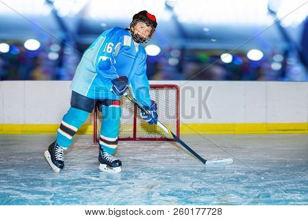 Teenage Hockey Player During Practice At Ice Arena