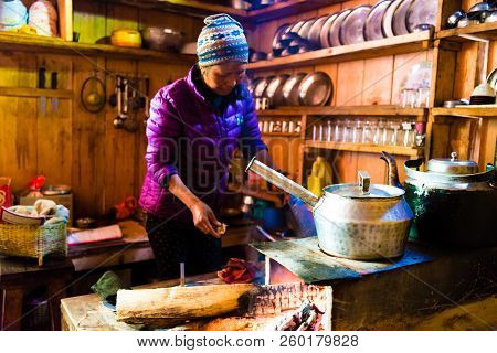 Food Preparation At Local Restaurant Lodge On The Trekking Circuit In Annapurna Conservation Area, N