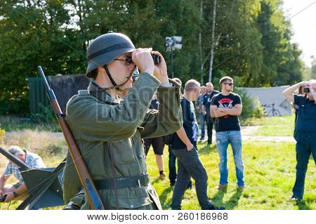 Enschede, The Netherlands - 01 Sept, 2018: German Soldier Watching Through Binoculars During A Milit
