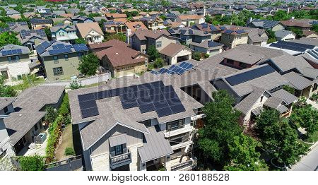 Aerial Drone View Of Solar Panels Covered All The Rooftops In A Renewable And Sustainable Neighborho