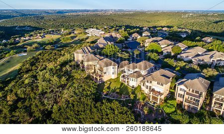 Aerial Drone View Above Rows Of Modern Luxury Homes On High Ridge Mountain Top Overlooking Texas Hil