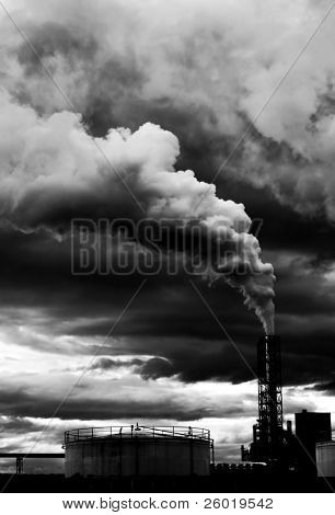 Polluting thick smoke coming out of factory chimney