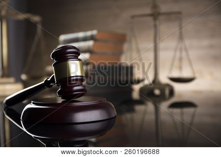 Law Theme. Courtroom Concept. Law Symbols Composition. Gavel, Balance And Books. Brown Background.
