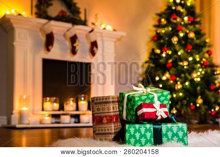 Some Nice Christmas Presents In A Living Room Filled Up With Winter Holidays Magic Atmosphere. Decor