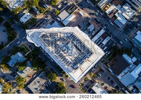 straight down aerial Top-Down drone view of Condo modern skyscraper in downtown Austin , Texas , USA with pentagon geometric shape abstract tower streets and intersections Ubran Modern City planning poster