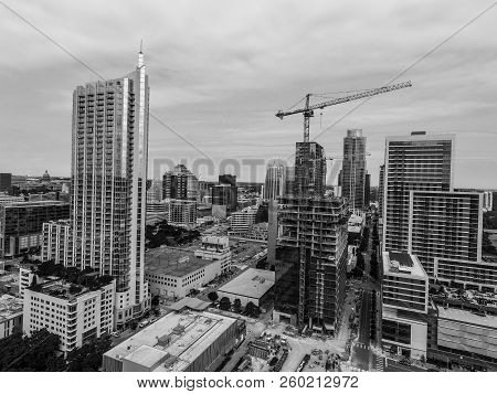 Austin Texas Downtown Skyline Rising Condos And Construction Crane Building A New Skyscraper That Wi