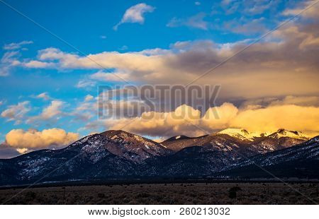 Golden Hour Sunset Peaks Above Taos New Mexico Winter Snow Covered Mountains Of The Rocky Mountains