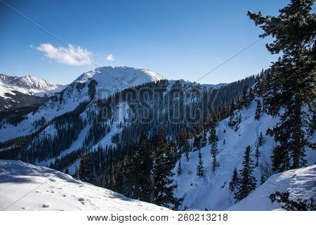 Snow Covered Valley Above Taos , New Mexico With Kachina Peak Standing Tall And Perfect Powder Snow
