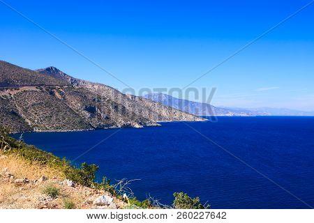 View From Cliff On Beautiful Greek Seaside Coastline. Sea Water, Blue Ocean.